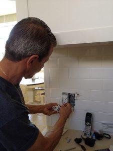 Electrician Allen Shapiro Determining Why a GFI Circuit Tripped in a Boca Raton Home.