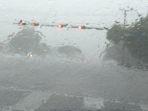 SLOW GOING: Heavy rain pummeled the area for hours this afternoon. This was the scene at Glades Road near Butts Road.