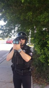 Boca Police Officer Adam Reisner checking speed this morning in a school zone. (Courtesy Boca PD).
