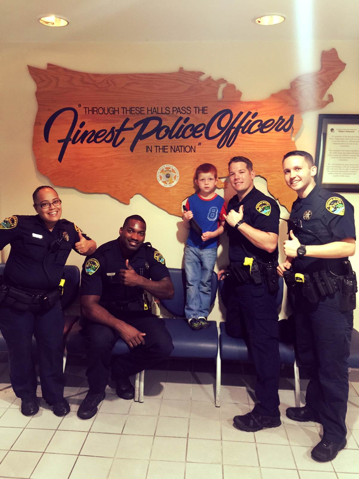 "Boynton Police Department's Bravo 3/4 shift, returning an iPad to six year old ""Aaron."""
